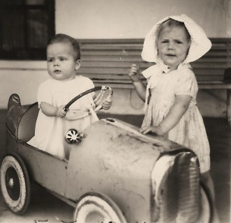 children with pedal car