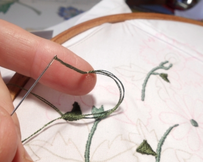 G: Junior's embroidery: oops, stitched through the skin of my finger