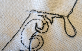 Finishing off a thread: weave through the stitching at the back of the cloth
